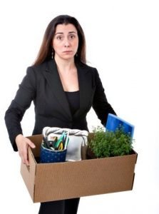 fired business woman with packed office stuff