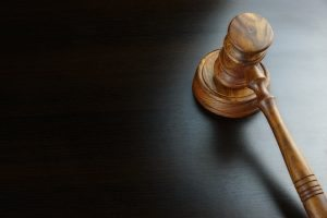 Gavel against black background